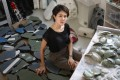 Leelee Chan in her Kwai Chung studio with recovered materials for use in future artworks. She is one of the participants in Up Close, a collaboration between Hollywood Road antiques stores and five contemporary artists. Photo: May Tse