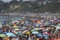 Crowds gather on the beach in Bournemouth, England on Thursday. Photo: PA via AP