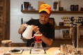 Coffee roaster Anson Wong makes a pour-over coffee at Elephant Grounds in Causeway Bay. Photo: Chen Xiaomei