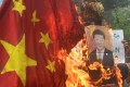 Indian protesters burn an effigy of Chinese President Xi Jinping in Kolkata. Photo: AFP