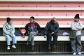 Elderly people gather near the football terraces at Southorn Playground in Wan Chai on January 14, 2014. The dividers on the terraces appear to be placed to prevent homeless people from sleeping there. Photo: SCMP