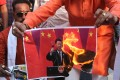 Activists of the Indian hardline Hindu organisation Bajrang Dal burn posters of Chinese President Xi Jinping and Chinese products as they protest against China during a rally in Bhopal. Photo: EPA-EFE