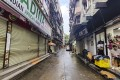 A closed restaurant and shops in Guangzhou's Xiaobei neighbourhood, as it starts to recover from the impact of the coronavirus. Photo: Reuters