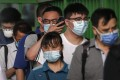 Commuters wearing face masks to help curb the spread of Covid-19 in Beijing, China. Photo: AP