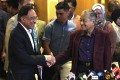 Malaysia's former prime minister Mahathir Mohamad with Anwar Ibrahim (L). Photo: AP