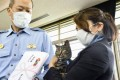 Tomoko Nitta and her cat Koko receive an award at a police station in Toyama. Photo: Kyodo