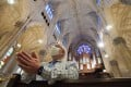 A man wearing a face mask prays inside St Patrick's Cathedral as it reopens for Mass at 25 per cent capacity amid the coronavirus pandemic in New York. Photo: AFP