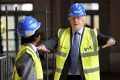 British Prime Minister Boris Johnson during a visit to the construction site of a school in west London. Photo: AP