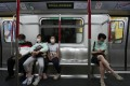 Hong Kong passengers practise social distancing while travelling on the MTR on April 11, in line with measures in place to avoid transmission of the novel coronavirus. Photo: Jonathan Wong