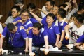 Lawmakers from Taiwan's ruling Democratic Progressive Party scuffle with lawmakers from the main opposition Kuomintang party, who have been occupying the Legislature Yuan, in Taipei, Taiwan, on Monday. Photo: Reuters