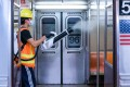 A contractor for the Metropolitan Transit Authority disinfects a subway train using an electrostatic sprayer in New York on June 10. Photo: Bloomberg