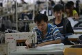 Sewing workers in a garment factory that exports to Europe, the United States and Japan, in Jiujiang city of Jiangxi province on February 29, 2020. Photo: Shutterstock