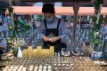Angus Gu, owner of Goos Jewellery, displays his wares at the BFC Weekend Market. Photo: Daniel Ren