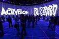 Attendees gather at the Activision Blizzard exhibit at the E3 (Electronic Entertainment Expo) in Los Angeles, California, USA, 12 June 2013. Photo: EPA-EFE