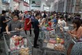Chinese consumers throng a Costco Wholesale store in Shanghai during the first week of its opening in August last year. The coronavirus pandemic has dented Chinese consumers' appetite for higher priced goods. Photo: EPA-EFE