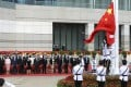Hong Kong officials and other dignitaries attend the flag-raising ceremony for the 23rd anniversary of the establishment of the Hong Kong Special Administrative Region, at Golden Bauhinia Square in Hong Kong. Photo: K.Y. Cheng