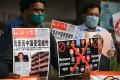 Members of the organisation Working Journalists of India hold placards urging citizens to remove Chinese apps and stop using Chinese products during a demonstration in New Delhi on June 30. Photo: Agence France-Presse