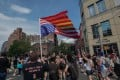 A man carries the American flag upside-down during the Queer Liberation March in New York on Sunday. Photo: AFP