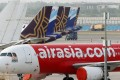 Aircraft operated by AirAsia, Vistara – a joint venture between Singapore Airlines and Tata Group – and IndiGo stand at Terminal 3 of Indira Gandhi International Airport in New Delhi. Photo: Bloomberg