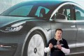 Tesla chief executive Elon Musk speaks onstage during a delivery event for the company's China-made Model 3 cars at its factory in Shanghai on January 7. Photo: Reuters