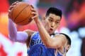 Jeremy Lin of the Beijing Ducks grabs a rebound during the match against the Zhejiang Golden Bulls. Photo: Xinhua