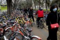 China's bike-sharing industry has faced tighter government regulations after a surge in supply during 2017 and 2018 led to streets crammed with leftover bikes that caused a major public nuisance. Photo: AP