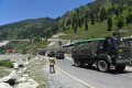 Indian army trucks travel along a highway leading to Ladakh, in Jammu and Kashmir, on Monday. Photo: EPA-EFE