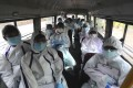 Health workers in India travel on a bus to conduct a free medical checkups in Mumbai. Coronavirus cases are surging in India, with over 600,000 infections. Photo: AP