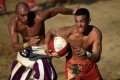 Players compete during the final of the annual calcio storico series in Florence, Italy. Photo: AFP