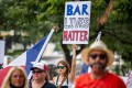 "A demonstrator holds up a sign during a ""Bar Lives Matter"" protest in Austin, Texas. Photo: Bloomberg"