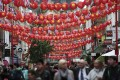 Chinese and British flags and paper lanterns are strung across Gerrard Street in London's Chinatown on October 19, 2015, ahead of a state visit by President Xi Jinping. Photo: Reuters