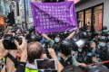 Police brought out for the first time a new, purple flag warning against breaking the national security law. Photo: Sam Tsang