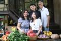 Emilia Nursanti Wibisono, known locally as Santi, her children Kay and Verena, and husband Satrio Wibisono, in front of their business, Organik Klub in Jakarta, Indonesia. Photo: Ade Mardiyati