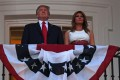 US President Donald Trump and first lady Melania Trump stand in the Truman Balcony at the White House as they host the 2020 'Salute to America' event. Photo: AFP