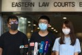 Opposition activists (from left) Ivan Lam, Joshua Wong and Agnes Chow outside Eastern Court. Photo: Sam Tsang