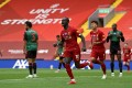 Liverpool's Sadio Mane celebrates breaking the deadlock against Aston Villa. Photo: DPA