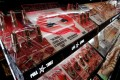 A plastic covers make-up products at a Sephora store in Paris, France. With so much of our face covered by a face mask, can lipstick sales survive the coronavirus? Photo: Reuters