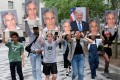 Protesters hold pictures of Jeffrey Epstein and Donald Trump outside federal court in New York in July 2019. Photo: TNS