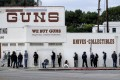 Americans wait in queue to enter a gun store amid the Covid-19 pandemic in Culver City, California, on March 15. Photo: AP