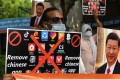 Members of the Working Journalists of India hold placards urging citizens to remove Chinese apps and stop using Chinese products during a protest in New Delhi on June 30. Photo: Photo: Agence France-Presse