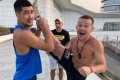 Petr Yan (right) with his coach John Hutchinson in Abu Dhabi ahead of UFC 251. Photo: @johnboyboxing