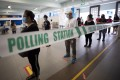 Voters queue to cast their ballots at a polling station in Singapore on July 10, 2020. Photo: EPA-EFE