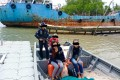 A handout photo made available by Johor police showing people smugglers and immigrants in a boat shortly before their arrest. Photo: Handout / Johor police