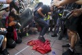 Protesters trample a Chinese flag during a September protest in Hong Kong. One man convicted of desecrating the flag on Friday saw his sentence increased from 240 hours of community service to five weeks in jail. Photo: Sam Tsang