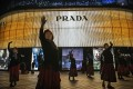 Chinese women dance outside a Prada store in Beijing, China. Chinese luxury shoppers spend US$111 billion a year on luxury goods worldwide, but the pandemic has seen them refocus their attention on the local market. Photo: Getty Images
