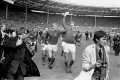 Jack Charlton holds the Jules Rimet trophy aloft as he parades it around Wembley with Bobby Moore after their 4-2 win over West Germany. Photo: AP