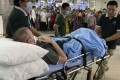 Stephen Cameron is wheeled out of the hospital to the airport to leave Vietnam on July 11, 2020. Photo: EPA-EFE