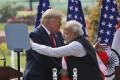 US President Donald Trump and Indian Prime Minister Narendra Modi embrace after giving a joint statement in New Delhi on February 25. Photo: AP