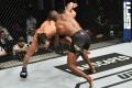 Kamaru Usman takes down Jorge Masvidal in their UFC welterweight championship fight during UFC 251. Photo: Jeff Bottari/Zuffa LLC