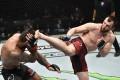 Muslim Salikhov kicks Elizeu Zaleski dos Santos in their welterweight fight during UFC 251. Photos: USA TODAY Sports